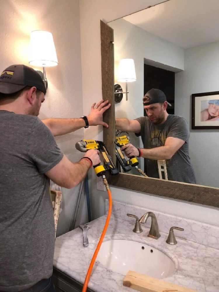 Chris nailing the frame into place in our master bathroom.