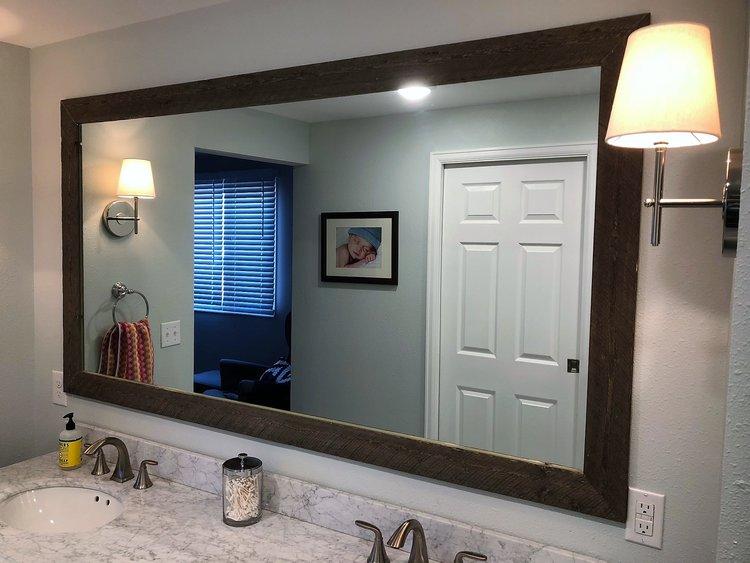 DIY frame for our bathroom mirror.