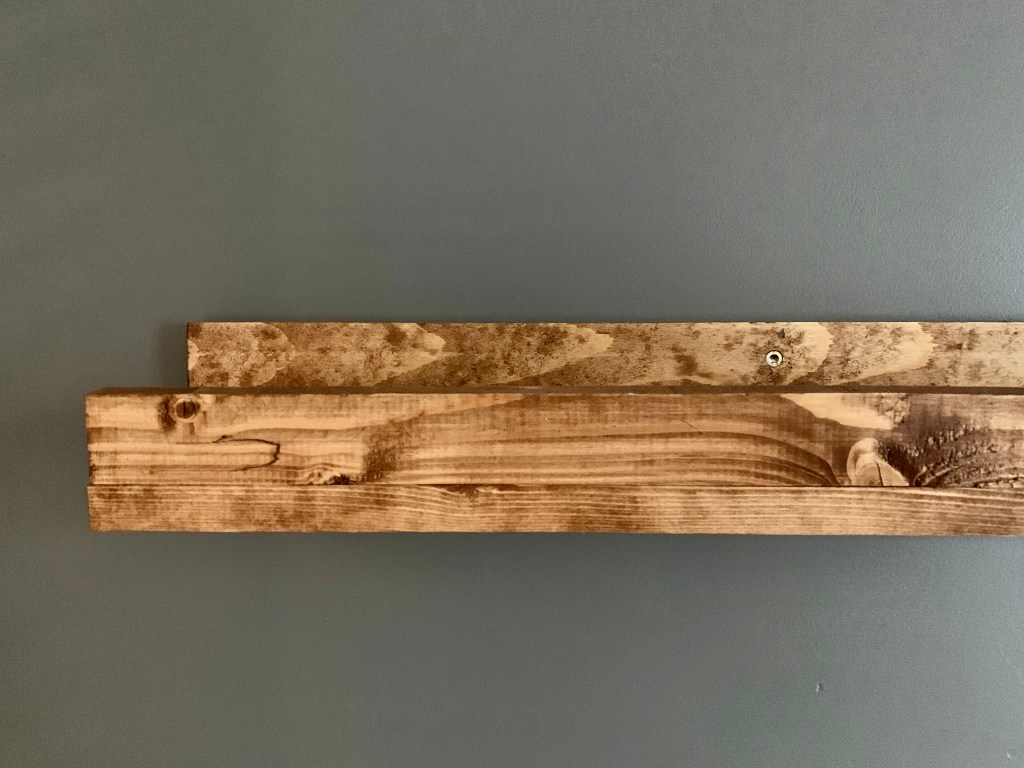Install the art ledge directly into a stud