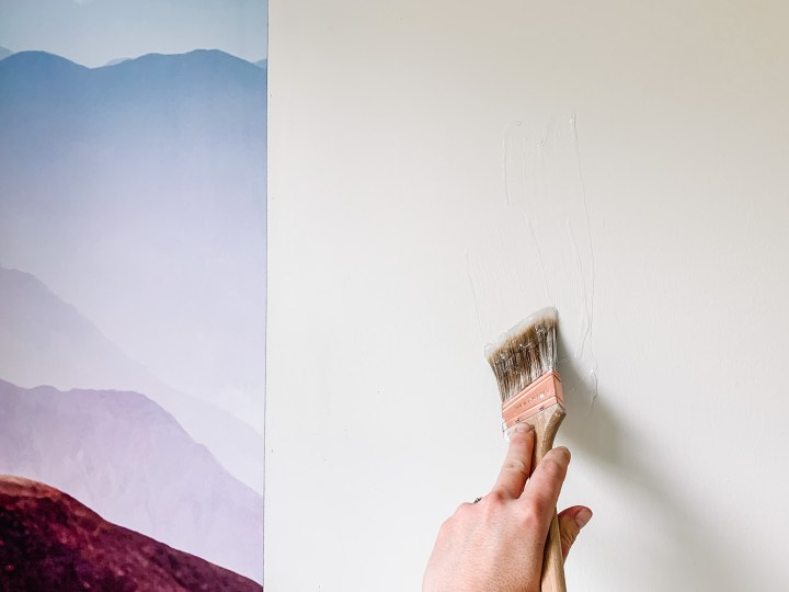 Hanging a Rebel Walls Gradient Mountain mural on the wall | Building Bluebird  #rebelwalls #tutorial #wallpaper #