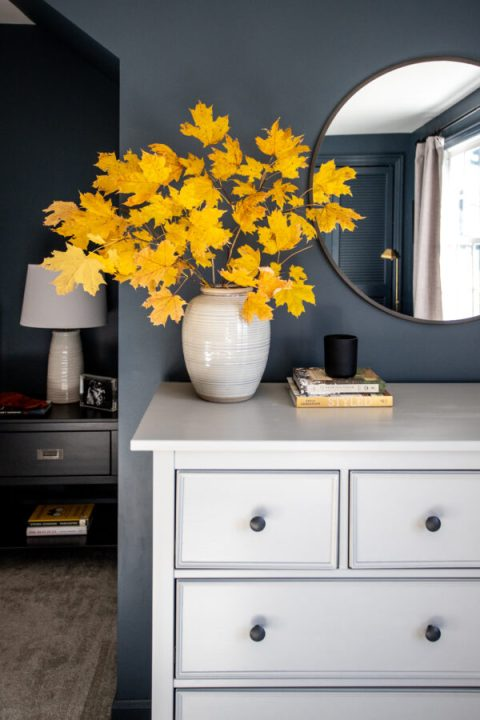 Fall foliage in a ceramic vase to compliment the dark walls and gray hemnes dresser | Building Bluebird #ikeahack #studiomcgee #targetstyle #styled #rustoleum