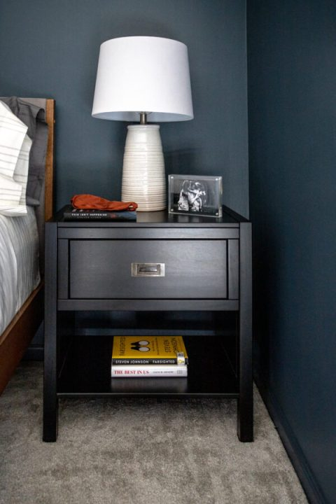 Simple nightstand decor with family photos for a personal touch | Building Bluebird #moodybedroom #moodypaint #bhgorc #modernbedroom #targetstyle