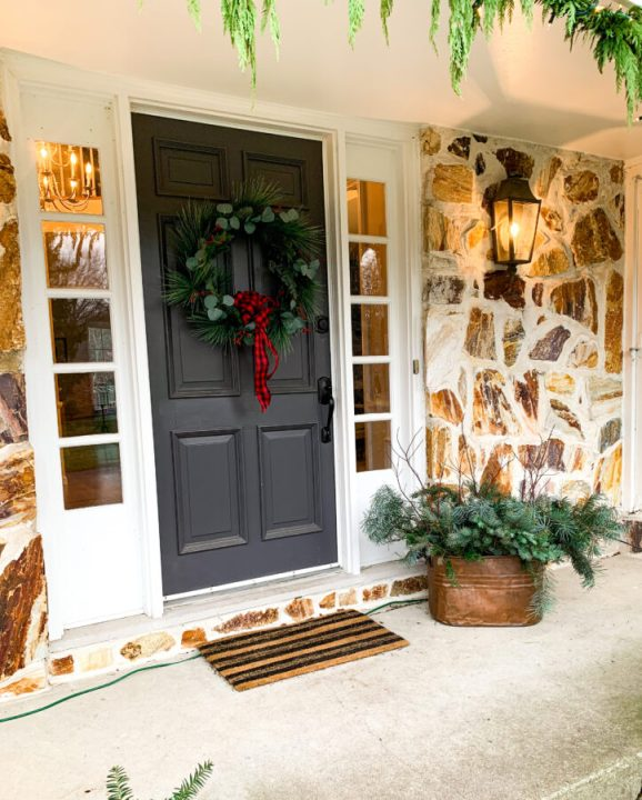 Forage your yard for festive clippings that are green and red and add them to a pot for beautiful holiday porch decor   Building Bluebrd #holidays #christmasdecor