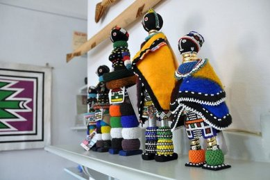 """""""Ndebele dols on show at the Africa Craft Trust (ATASA Trust) Exhibition in Johannesburg on June 10, 2010. Photo by Lauren Barkume"""" on Aid to Artisans Facebook page."""