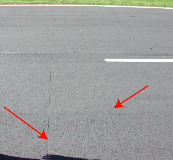 A photograph of the in-road scoring loops at Charlotte Motor Speedway