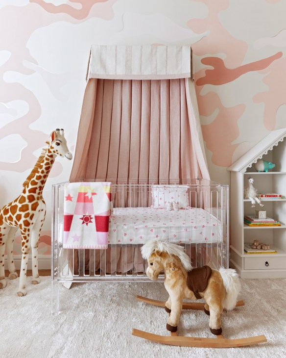 Pink nursery with canopy crib