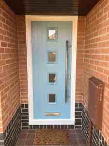 New light blue front door