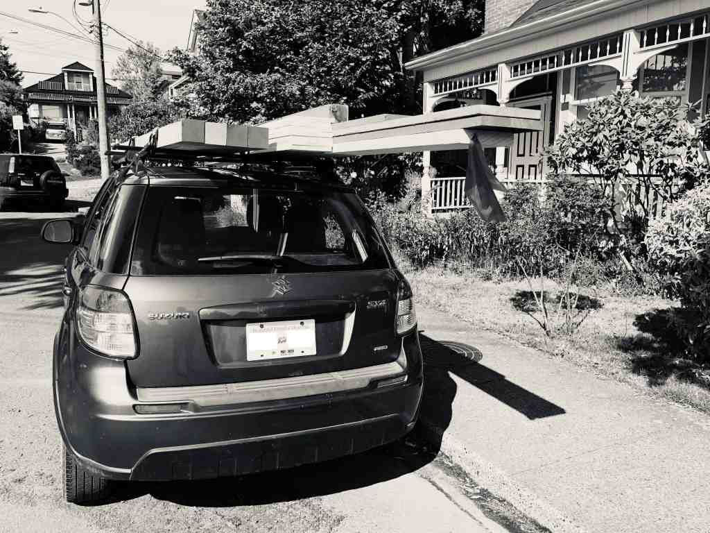 lumber strapped on roof rack on car