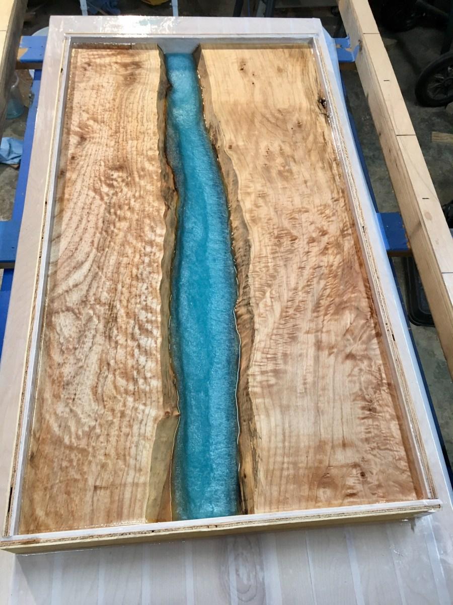 pour epoxy into table build process photo