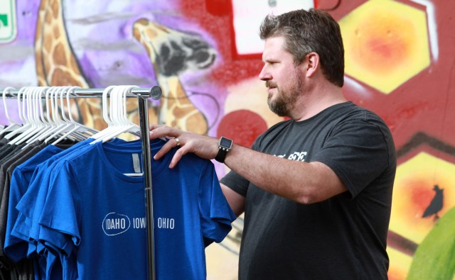 Paul Carew organizing Boise Wear T-shirts