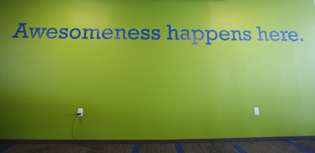 "MetaGeek's office wall reads, ""Awesomeness happens here"""