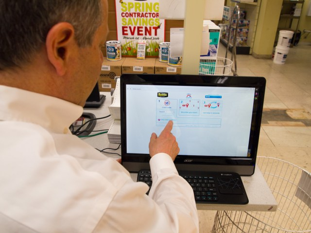 Locate Express owner Doug Joseph using a Locate Express kiosk