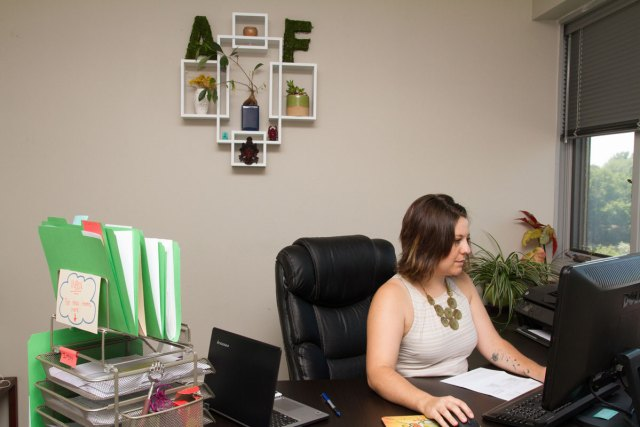 "The Auction Frogs ""A"" and ""F"" are scattered throughout the office."