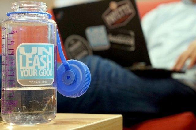 "A water bottle with One4All slogan ""Unleash Your Good"""