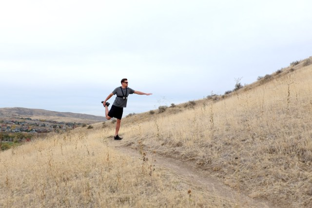 August Johnson stretching on Boise foothill trail