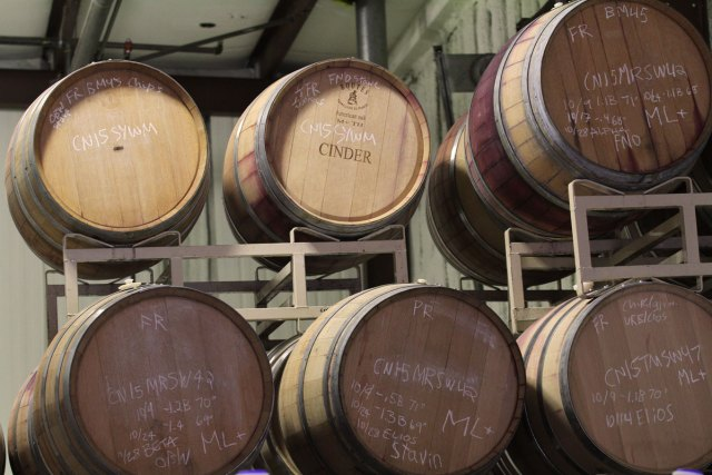 """Wine barrels with one marked """"Cinder"""""""