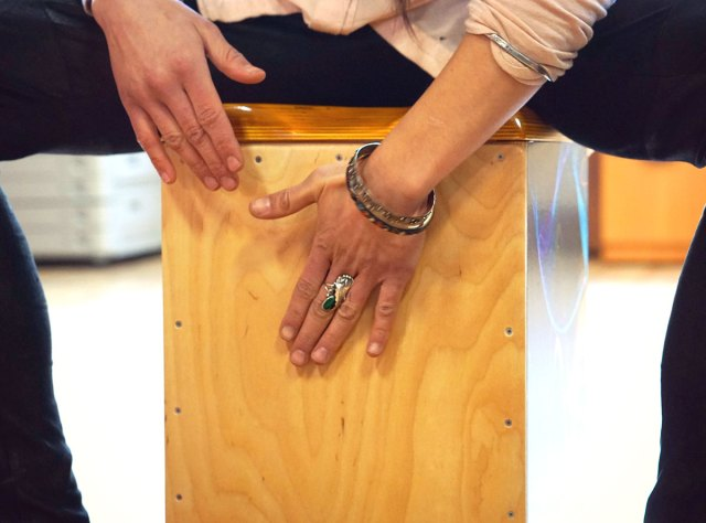 Woman playing the cajon