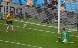 Australia's Jason Davidson and Australia's goalkeeper Mat Ryan watch as a shot from Spain's Juan Mata goes into the net for his side's third goal during the group B World Cup soccer match between Australia and Spain at the Arena da Baixada in Curitiba, Brazil, Monday, June 23, 2014. (AP Photo/Michael Sohn)