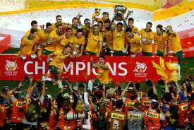 Australia's players celebrate with the Asian Cup trophy after winning their final soccer match against South Korea in Sydney