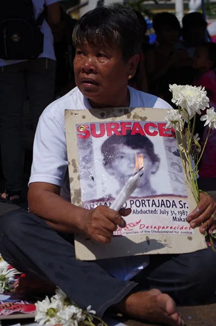 Guy Portajada never loses hope of finding her missing husband, Armando Sr. (Photo by Ronalyn V. Olea / Bulatlat.com)