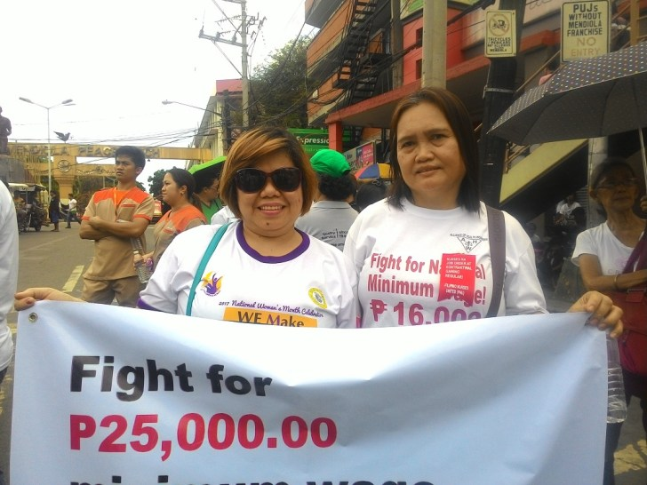 Desiree Reyes (left) and her co-worker in Tondo General Hospital during the commemoration of National Health Workers' Day in Mendiola. (Photo by A. Umil/ Bulatlat)