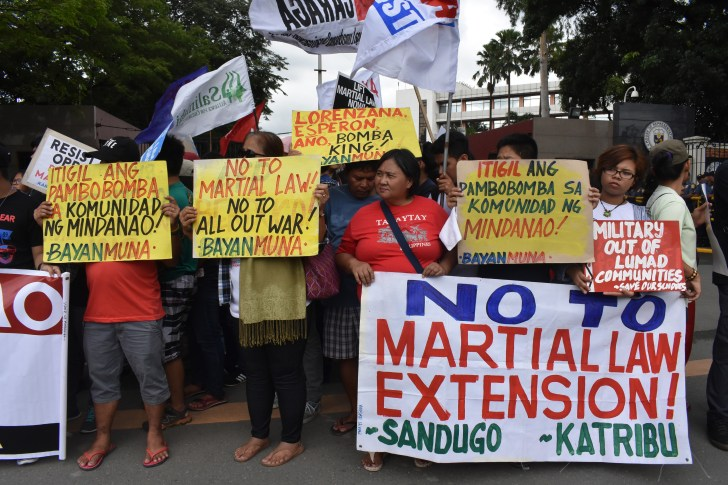 Protesters picket outside the House of Representatives during the joint special session of Congress to vote on martial law extension (Photo by Ian Irving Bazarte/Bulatlat)