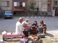 Making leutenitza on the sidewalk in front of our blok.