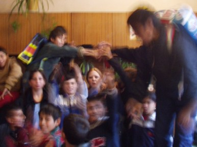 Brian's class, with Lisa in the eye of an excitement hurricane.