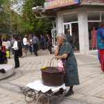 Baba selling corn from street cart in Pazardjik, Bulgaria