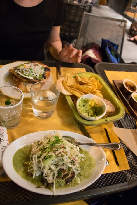 asparagus & egg tosta in the back, enchiladas verdes in the foreground with a pear-basil margarita between