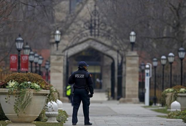 A member of the University of Chicago Police patrols the campus in Chicago, Illinois, United States, November 30, 2015.   REUTERS/Jim Young