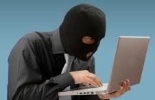 Guy in Ski Mask holding Laptop