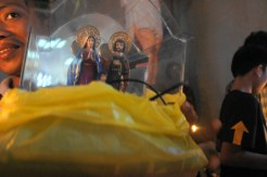 A village resident brought along an image of the Holy Family for blessing.