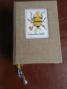 Hardbound Notebook with an Inset Beetle Illustration