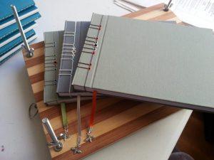 Stab bound books in plain cloth