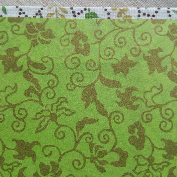 Bright green hanji endpapers in a white sketchbook