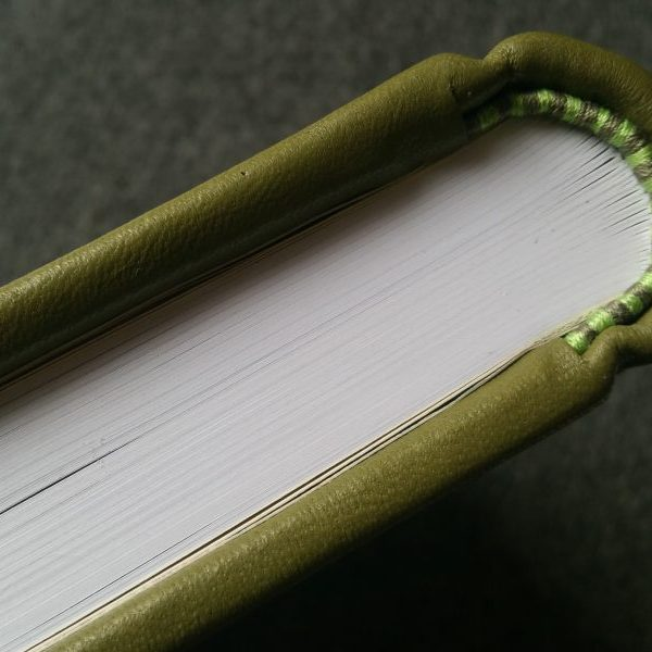 Hand-sewn Endbands on a green leather book