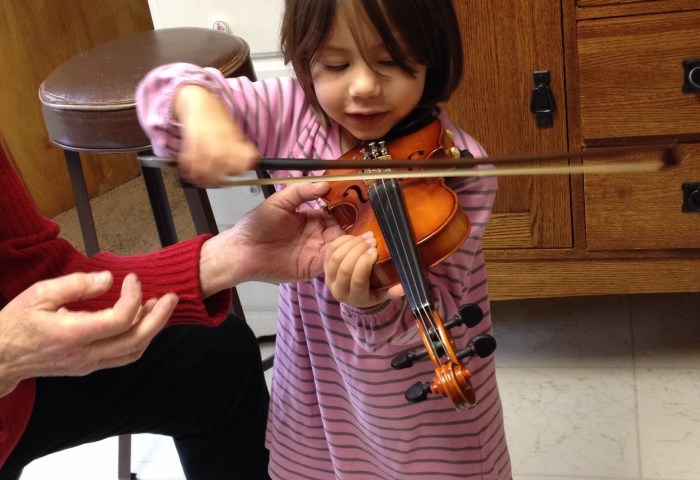 The cutest violinist ever and you'll need to turn down the volume
