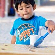 Child using shovel