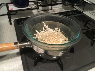 Creating a makeshift double boiler to steam the enoki
