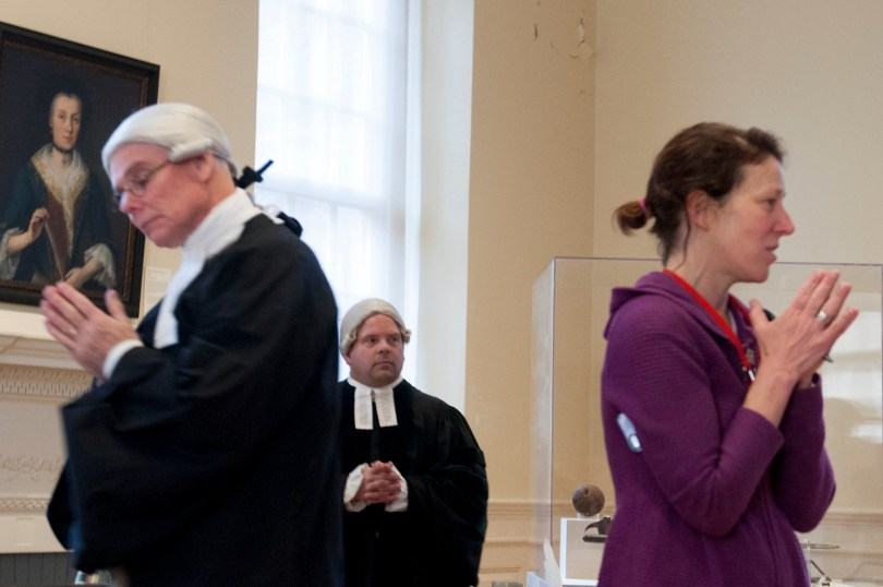 "BOSTON, March 5th, 2016: Left to right: Actors Ed Hurley, Mike LePage listen to Kathy Mulvaney, educator at Old State House as she explains the audience roles, in the interactive play ""Trial of the Century"". The play is a part of the Old State House's program in commemoration of the Boston Massacre. (Marwa Morgan/BUNS)"