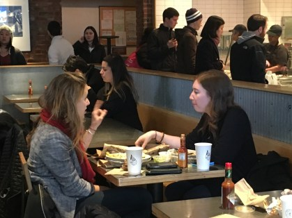 Two women eat at a Washington, D.C. Chipotle on Feb. 19 after the company announced new safety  measures after several food safety scares in the second half of 2015. (Photo by Toni Ann Booras/BU News Service)