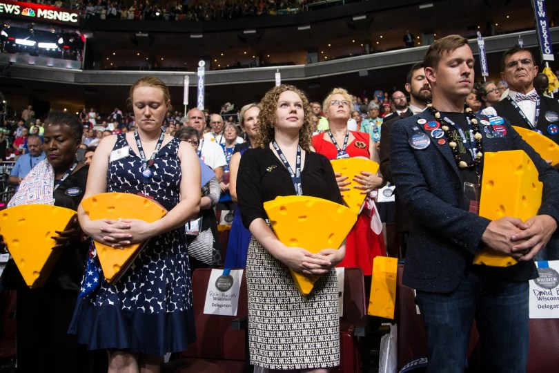Wisconsin delegates hold on to their popular cheeseheads during the opening prayer on the last day of DNC. Photo by Pankaj Khadka/BUNS