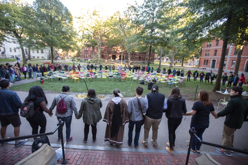 "About 100 people participated in the circle dance. After the celebration, traditional Native American foods like fry bread was served in Harvard's Ticknor Lounge. ""The culture is important,"" said Caminsky. ""We have an identity. We're not forgotten. We're still here."" Photo by Alexandra Wimley/BU News Service"