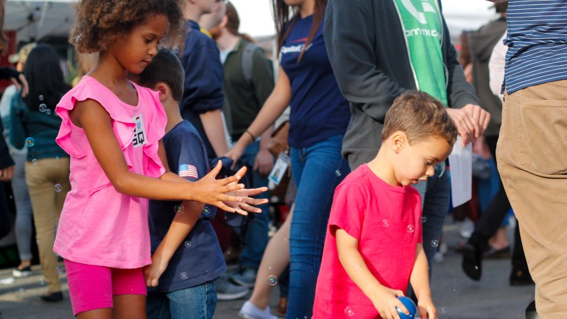 Kids play with bubbles at the 2018 Fluff Festival. Somerville, Mass. September 22, 2018. Photo by Diego Marcano.