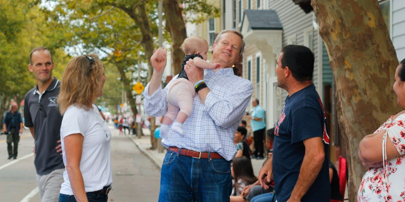 Governor Charlie Baker greeted people at the Columbus Day Parade in East Boston, on Sunday, Oct. 7. Photo by Flaviana Sandoval / BU News Service