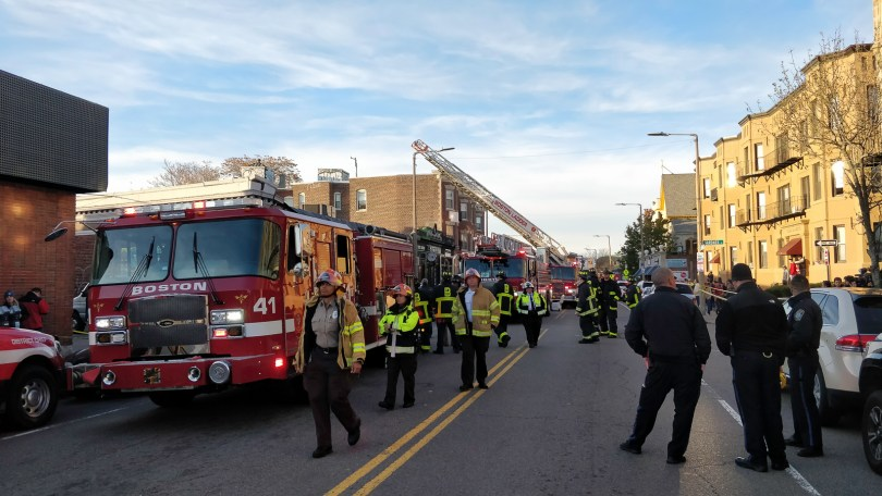 Boston Police and Fire Department officers block the street after a partial roof collapse at Common Ground Bar & Grill in Allston, Nov. 4. Photo by Aaron Ye / BU News Service.