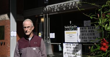 Voter in front of the polling station at Saint Cecilia Parish