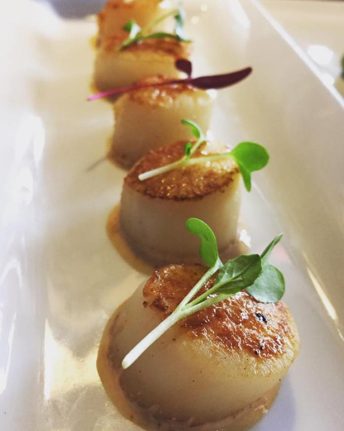 Seared scallops photo via Sodo Sushi Facebook page