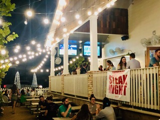 Porch with lights with Streak Night Sign